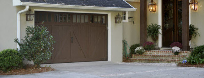 brown garage door with windows