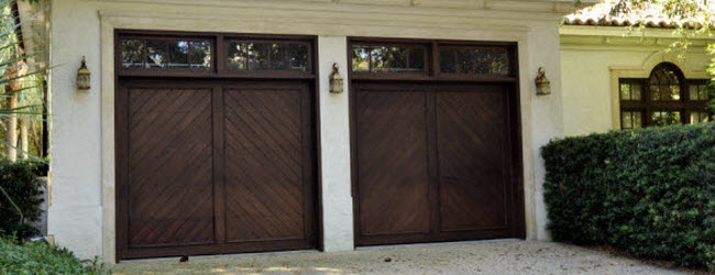 slanted panels wood garage doors with windows