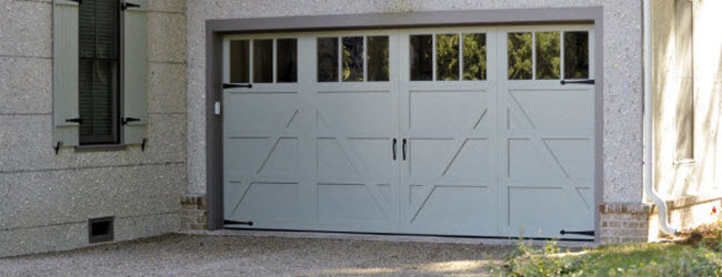 white garage doors carriage style with windows
