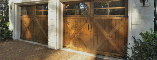 wood garage doors with x design and windows