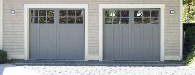 gray square panel wood garage door with windows