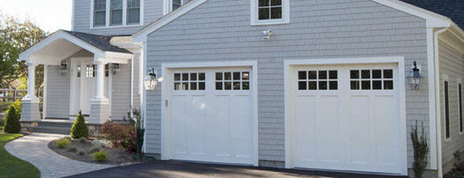 wood painted white garage doors with windows