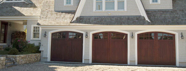 arched top wood garage doors with windows
