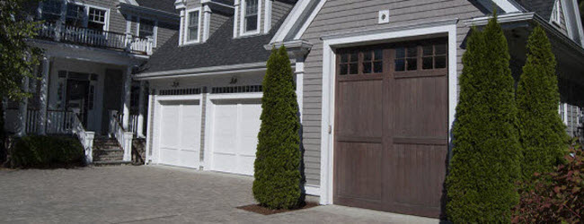 tall brown wood garage door with windows