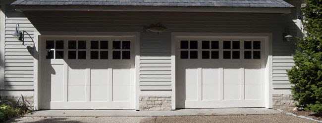 white wood garage doors with windows
