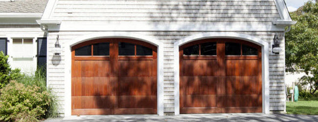 orange colored wood garage doors with windows
