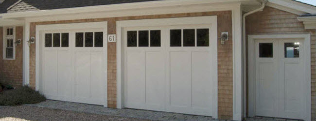 white wood garage door with windows