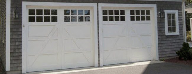carriage house style white wood garage doors with windows