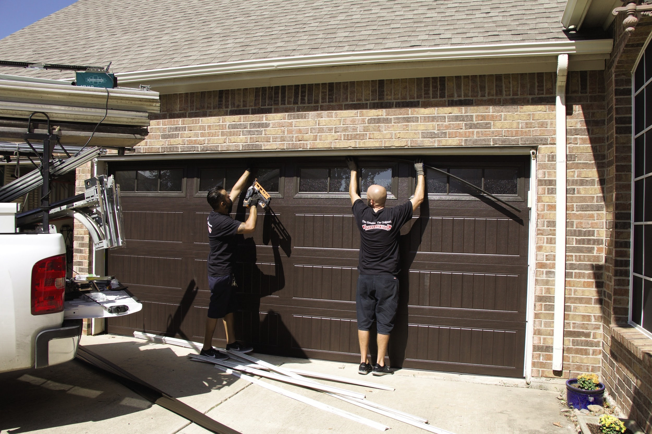 OHD installers installing a new garage door